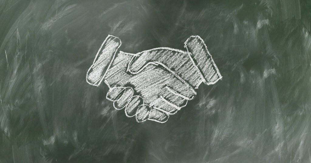 This image has an empty alt attribute; its file name is shaking-hands-teamwork-1024x538.jpg